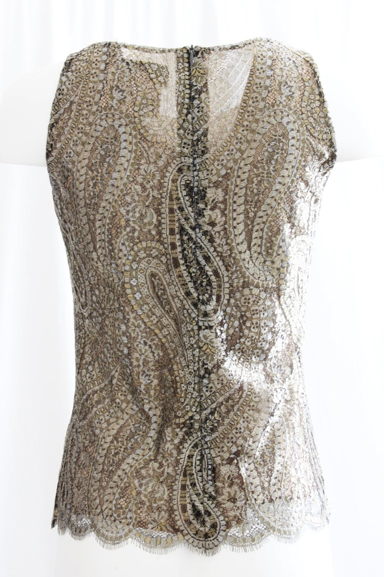 This lovely sleeveless top was made by Chanel for their 2013 collection.  Made from a stunning gold tone metallic lace in a paisley motif, it's lined in nude silk fabric.  Fastens with a hidden rear zipper and looks amazing with black (as shown in
