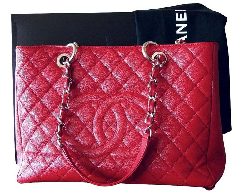 ce865a1467d5 This iconic bag from Chanel is made from an eye-catching rouge red caviar  leather