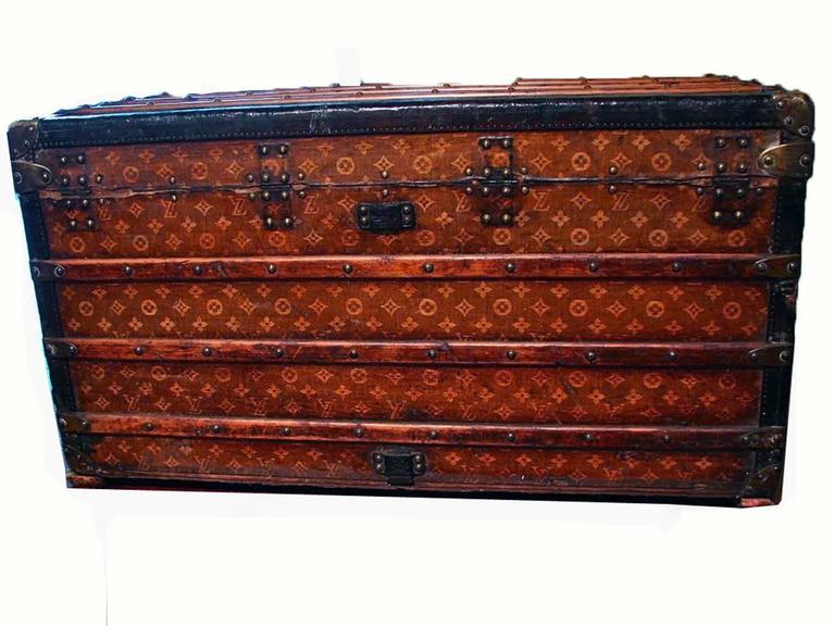 This iconic steamer trunk dates to the early 1900s and is made from Vuitton's monogram canvas (handwoven, which is typical of trunks made prior to 1905), leather trim and brass hardware & handles.  The interior is lined in cream fabric and features