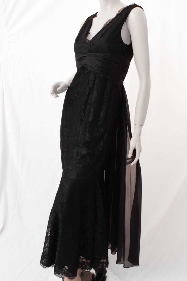 Look fabulous this holiday season in this sizzling black silk lace evening gown from Pamella Roland.  We love the sheer silk panels in back and the body-hugging mermaid hem! Fully-lined and in excellent preowned condition with minimal signs of prior