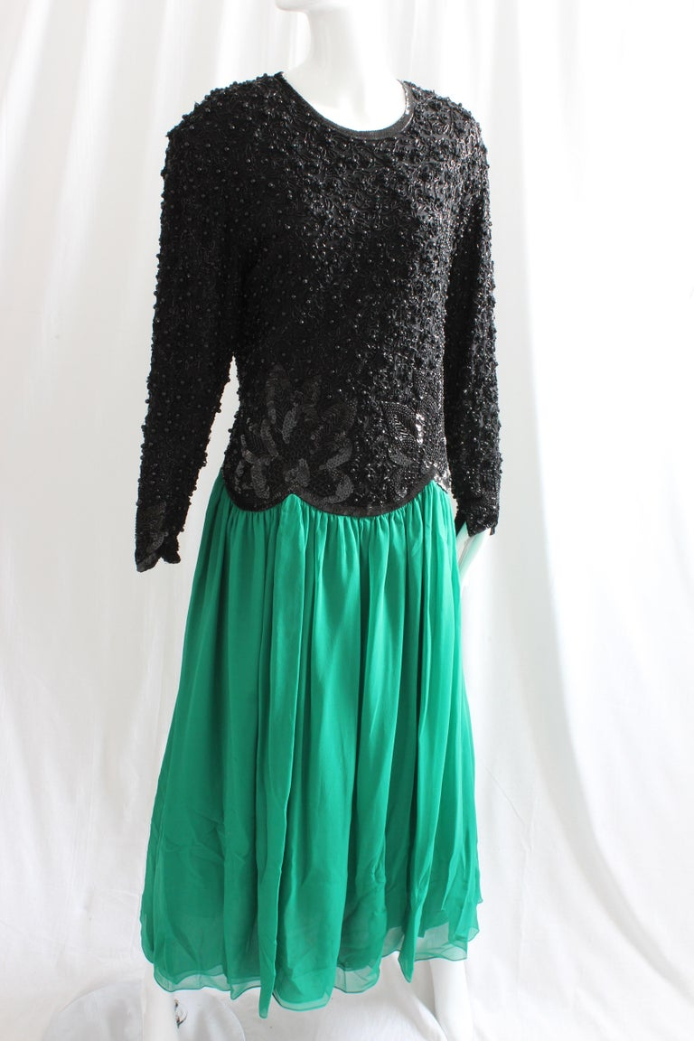 Naeem Khan for Riazee vintage evening gown in black/green silk.   Top features intricate beading throughout and skirt is made from layers of silk chiffon.  Preowned/vintage with minor signs of prior wear.  No size tag, but we're estimating this as a