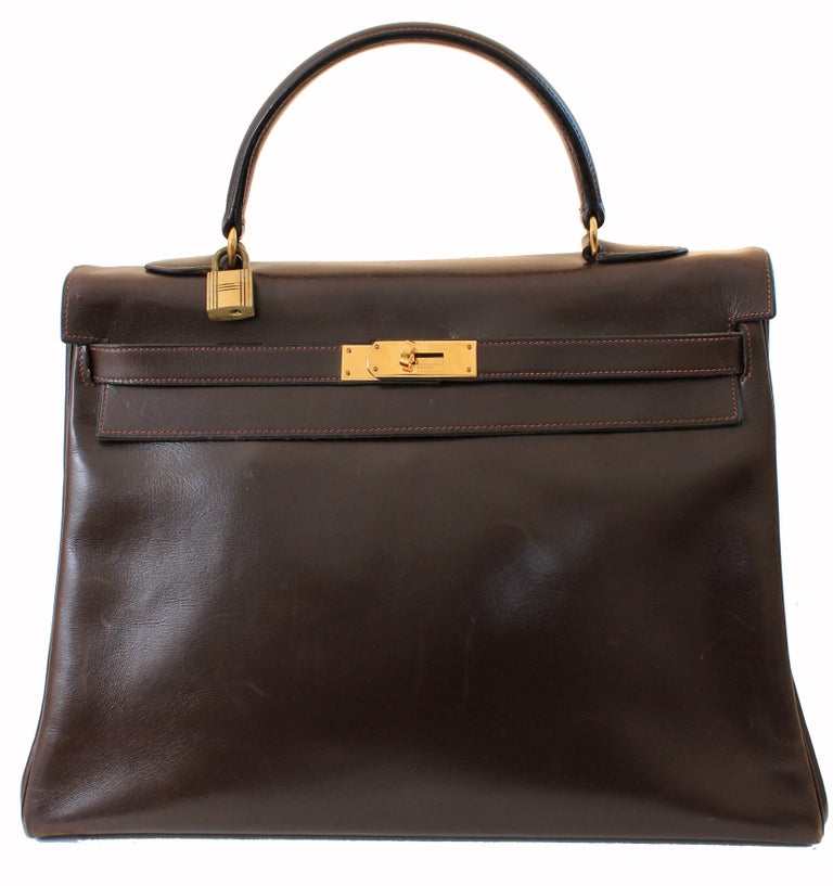 This fabulous handbag was made by Hermes in 1945.  Originally coined the Sac a Depeches - this piece was made about 12 years before Grace Kelly wore the style that we now know as the Kelly bag.  Made from Hermes signature box leather in a deep brown