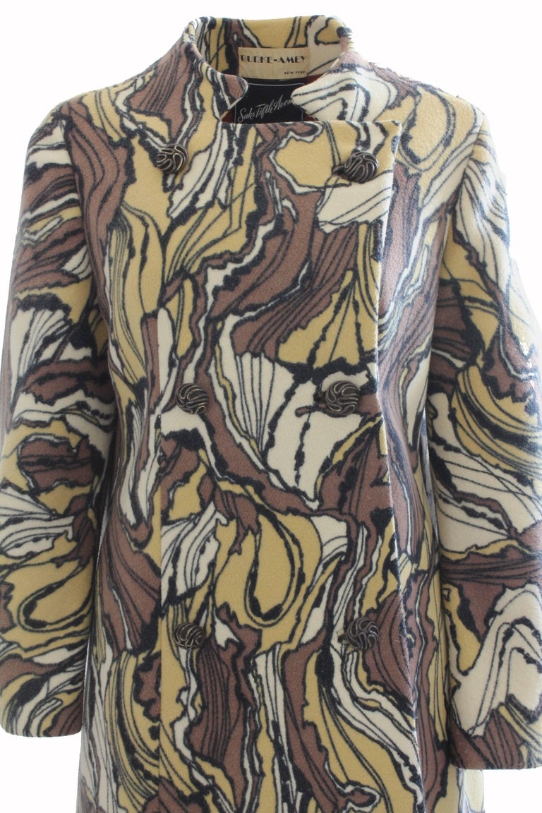 Here's a hard-to-find and incredibly stunning coat from Ronald Amey, made for his Burke-Amey label in the 1960s. Made from a fabulous abstract print wool from textile genius Tzaims Luksus, this piece also features a sculptural collar and is