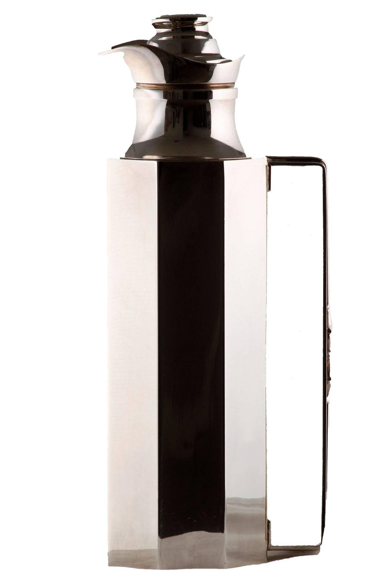 This rare insulated bar decanter or carafe was made by Gucci, most likely in the late 1970s.  Made from silver plate, it features an octagon shape, a horse bit motif on the handle, an inner thermos with glass liner and an insulated lid covered in