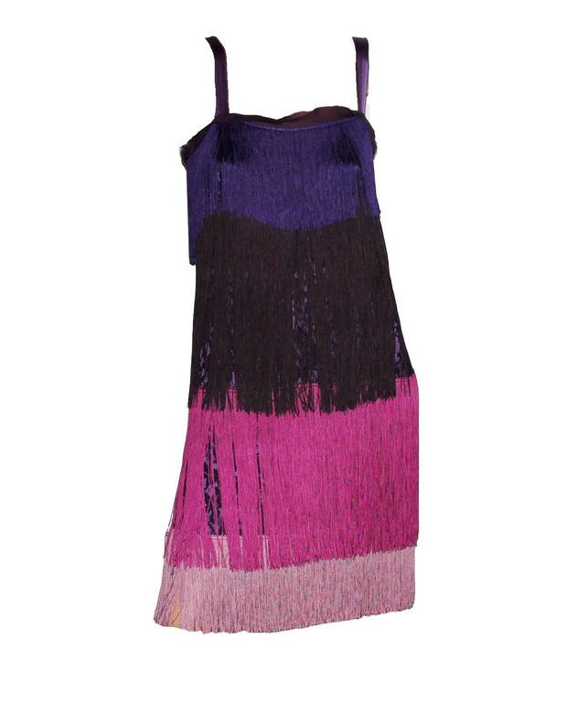 GORGEOUS DOLCE & GABBANA SILK FRINGE  DRESS  FLAPPER DRESS AS FROM THE MOVIE THE GREAT GATSBY  Condition: Brandnew with tags  Made out of a purple lace fabric that shines through the fringes Purple underdress Colorblock fringes Retail price