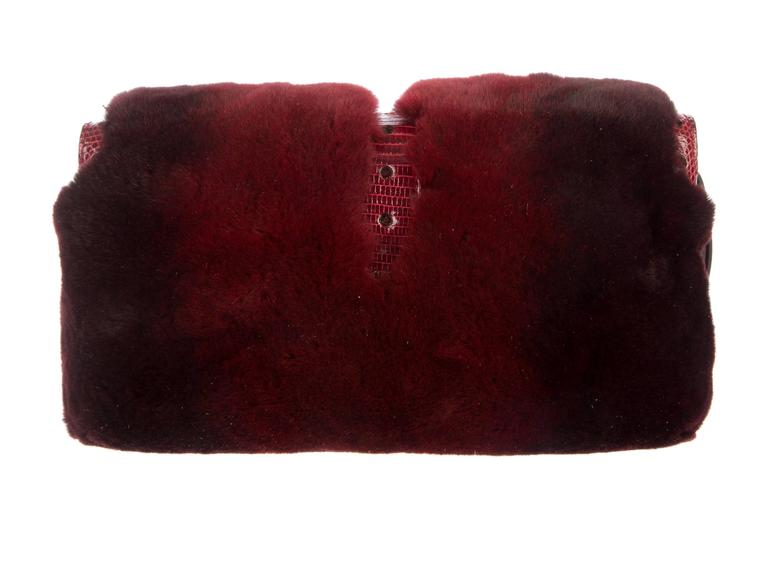 A GUCCI signature piece that will last you for many years Very rare Collector's item Only very few pieces were made and sold in selected boutiques Made of beautiful burgundy fur (probably shorn mink?) Huge handcrafted jeweled clasp discreetly