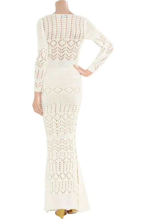 ABSOLUTELY INSANE EMILIO PUCCI WHITE CROCHET KNIT CUTOUT GOWN  DESIGNED BY PETER DUNDAS  SOLD OUT IMMEDIATELY  WORN BY TOPMODELS AS CLAUDIA SCHIFFER, MIRANDA KERR,  DETAILS:      Exclusive and gorgeous EMILIO PUCCI crochet knit gown     Sexy cutout