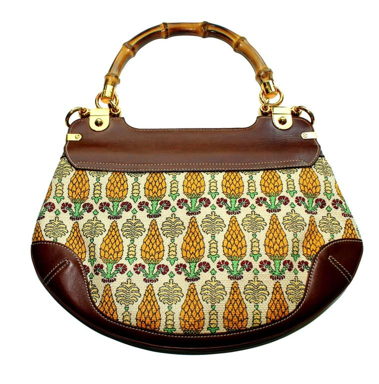 """2d36c98e8a9c A signature bag by Gucci in the famous """"Pigna"""" print with  pineapple cones"""