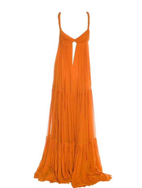Stunning orange Gucci evening gown Seen on Blake Lively A truly gorgeous piece Layered finest silk Plisee details Full length Gold hardware details on straps 100% Silk Special Dry Clean only This gown retailed at Gucci for 7499$