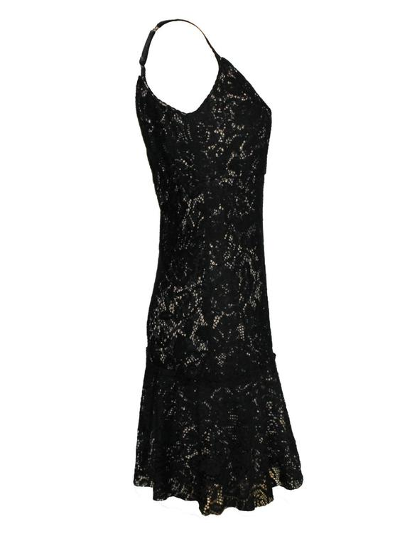 DOLCE & GABBANA BLACK CROCHET KNIT LACE PRINT SILK DRESS  DETAILS:      A DOLCE & GABBANA classic signature piece that will last you for years     From Dolce & Gabbana main line     Made out of a fantastic soft black knitted lace     Lined with