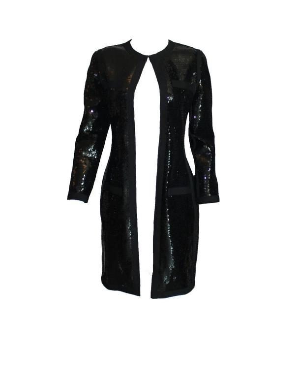 A stunning piece by Chanel Designed by Karl Lagerfeld A very versatile piece - can be worn as dress, coat or jacket Shiny black sequins Closes in front with a zip with CC logo Fully lined with black silk Perfect condition Made in France Dry Clean