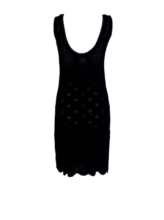 Lovely new interpretation of the timeless Chanel classic little black dress A true Chanel signature piece that will last for many years 3D crochet knit Two front pockets CC logo buttons Simply slips on Made in France Dry Clean Only