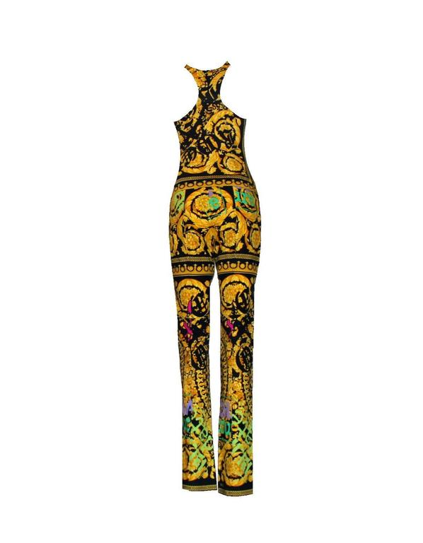A colorful ensemble by Versace Siganture print with the famous Versace medusa head Full length pants Top made of soft fabric with racer back Made in Italy
