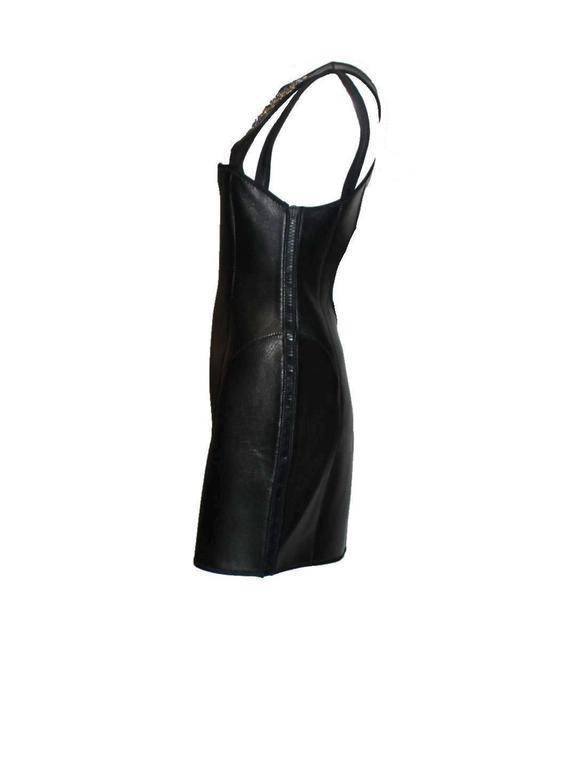 Unique piece by Peter Dundas designed for Emilio Pucci Collectable piece Extraordinary material combination Softest lambskin glove leather combined with neoprene Diver-style fully opening zippers on both sides Cut-out details Deep back