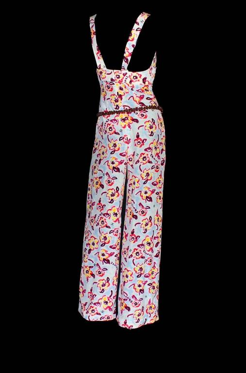 Stunning Chanel Jumpsuit designed by Karl Lagerfeld         Unique vintage piece         Two straps attched with Chanel buttons         Hidden zip on back         Wide palazzo style legs         Four front pockets         Chanel logo
