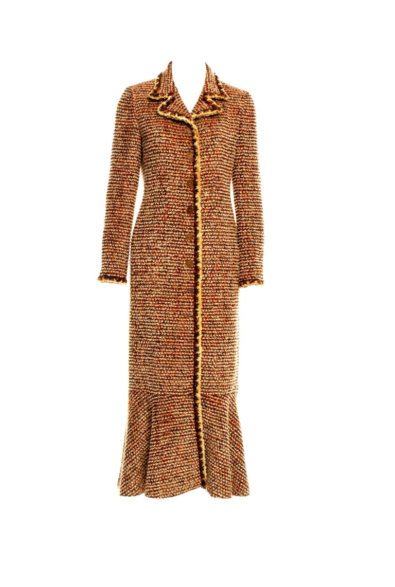 AMAZING & RARE  CHANEL TWEED COAT  DESIGNED BY KARL LAGERFELD  A TRUE CHANEL PIECE THAT SHOULD BE IN EVERY WOMAN'S WARDROBE - THIS COAT IS ALMOST LIKE COUTURE  DETAILS: Beautiful CHANEL tweed coat designed by Karl Lagerfeld A true CHANEL signature