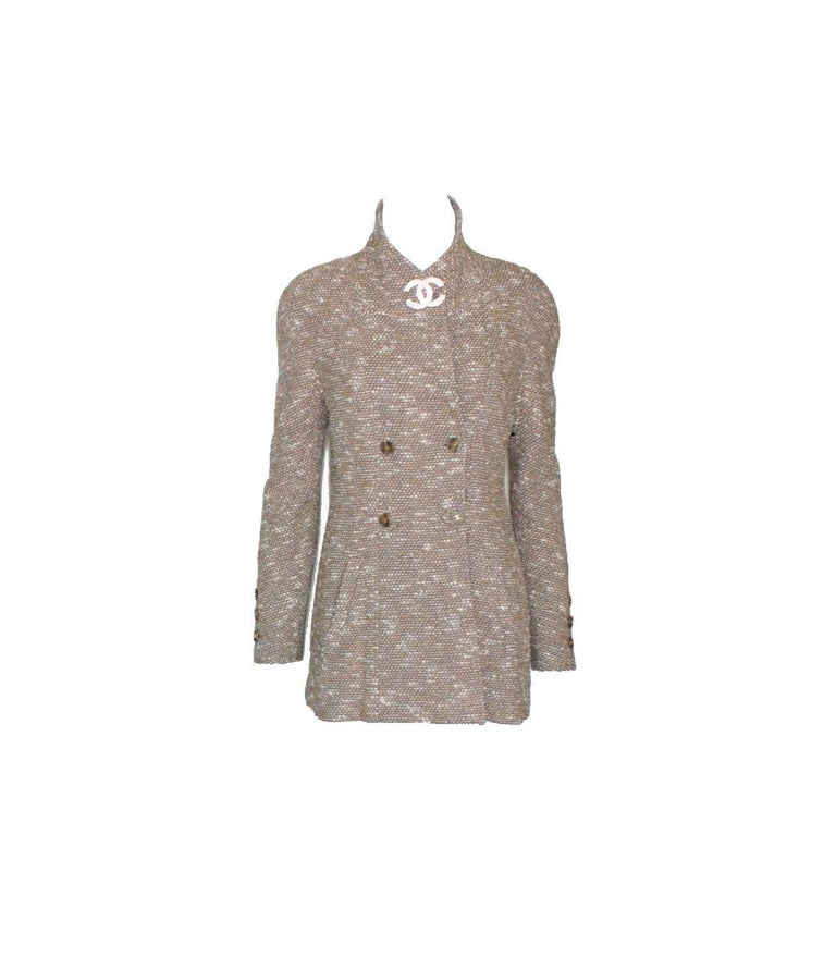 Beautiful CHANEL tweed coat designed by Karl Lagerfeld A true CHANEL signature item that will last you for many years Stunning colors in light brown, cream and blue, perfect with jeans! A truly versatile piece, can be worn as blazer, jacket or short