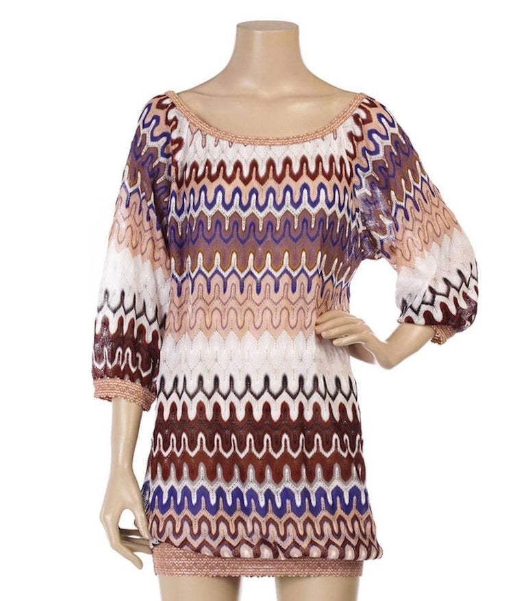 Stunning dress from MISSONI main line Beautiful shades Classic MISSONI signature zigzag crochet knit Simply slips on Bateau neck Batwing / Dolman half-length sleeves Contrast trim Elasticated neck and hem 100% Rayon Dry Clean only Size 38