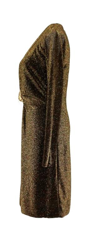 Stunning Dress by Tom Ford for Gucci From his collection for Gucci in Fall/Winter 2000 Long sleeves Deep Plunging Neckline Gold-colored metal hardware lion brooch in front Made in Italy Dry Clean Only Size 42 Brandnew with original tags still