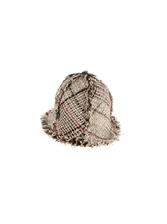 Beautiful CHANEL fantasy tweed hat by Karl Lagerfeld     A true CHANEL signature item that will last you for many years     Amazing tweed fabric     Frayed details     Beautiful CC logo enblem in front     Made in France     One size     Just