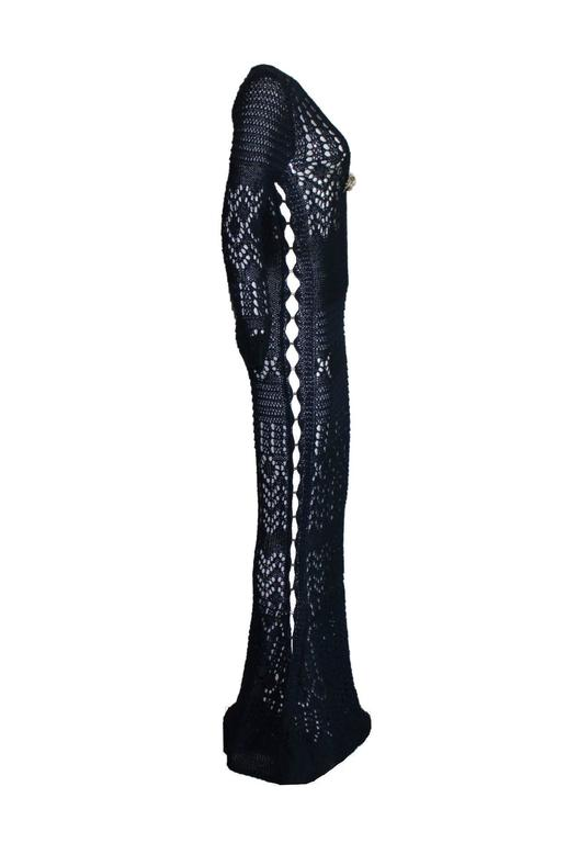 ABSOLUTELY INSANE EMILIO PUCCI MIDNIGHT BLUE CROCHET KNIT CUTOUT GOWN  DESIGNED BY PETER DUNDAS  SOLD OUT IMMEDIATELY  WORN BY TOPMODELS AS CLAUDIA SCHIFFER, MIRANDA KERR AND MANY OTHERS   DETAILS:      Exclusive and gorgeous EMILIO PUCCI crochet
