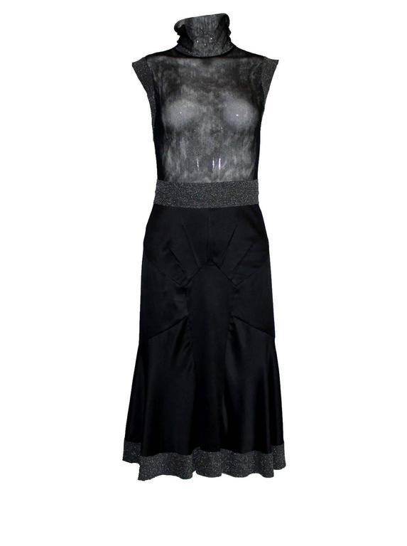 Sublime cocktail dress by Dolce & Gabbana Very versatile, worn camisole for a modest look or sexy with just a bra! Black tulle mesh bodice with stand up collar Lurex trimming on sleeves and waist Decorative zip in back with crystal trimming Made