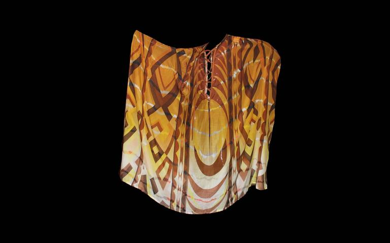 "A stunning piece by Emilio Pucci Maxi kaftan dress Made of finest silk & cotton voile fabric Signature print signed with ""Emilio"" all over Leather lace up detail Batwing sleeves Made in Italy"