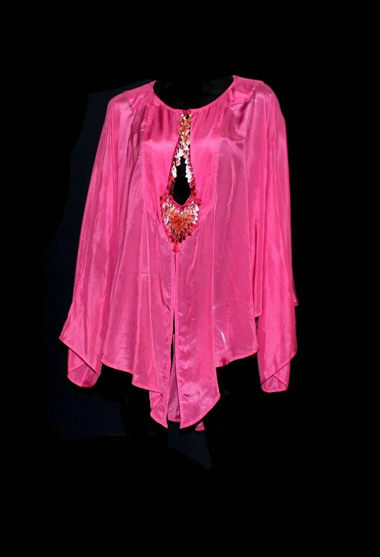 Stunning piece by Tom Ford for Gucci Desiged for Gucci  Beautiful hot pink silk Batwing sleeves Gorgeous ombre tassels with macrame knitting Cleavage can be opened up more with button Made in Italy Dry Clean Only Size 42