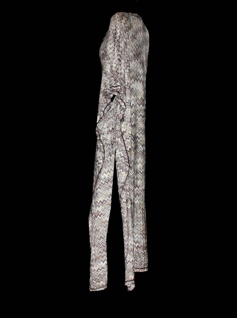 Stunning Missoni Ensemble   Missoni Mare's kaftan is a '70s-inspired poolside piece. Team this classic crochet knit kaftan with the matching bikini for a beautifully bold vacation look.   Signature chevron crochet-knit maxi dress Full length kaftan