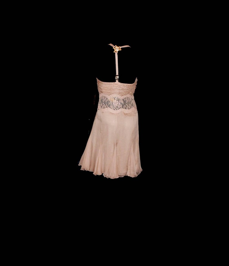 GORGEOUS VERSACE NUDE BLUSH SILK DRESS        A VERSACE signature piece     Seen on Teri Hatcher, Liz Hurley and many others     Beautiful blush silk     Ruched details  Finest french lace insert      Golden medusa signature plates Corset inside for