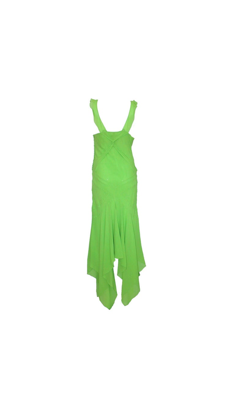 An extremely luxurious and CHRISTIAN DIOR signature piece that will last you for years Gorgeous, couture-like piece hand-crafted by the seamstresses in Christian Dior's atelier in Paris, FRANCE Made out of most beautiful green chiffon silk  Amazing