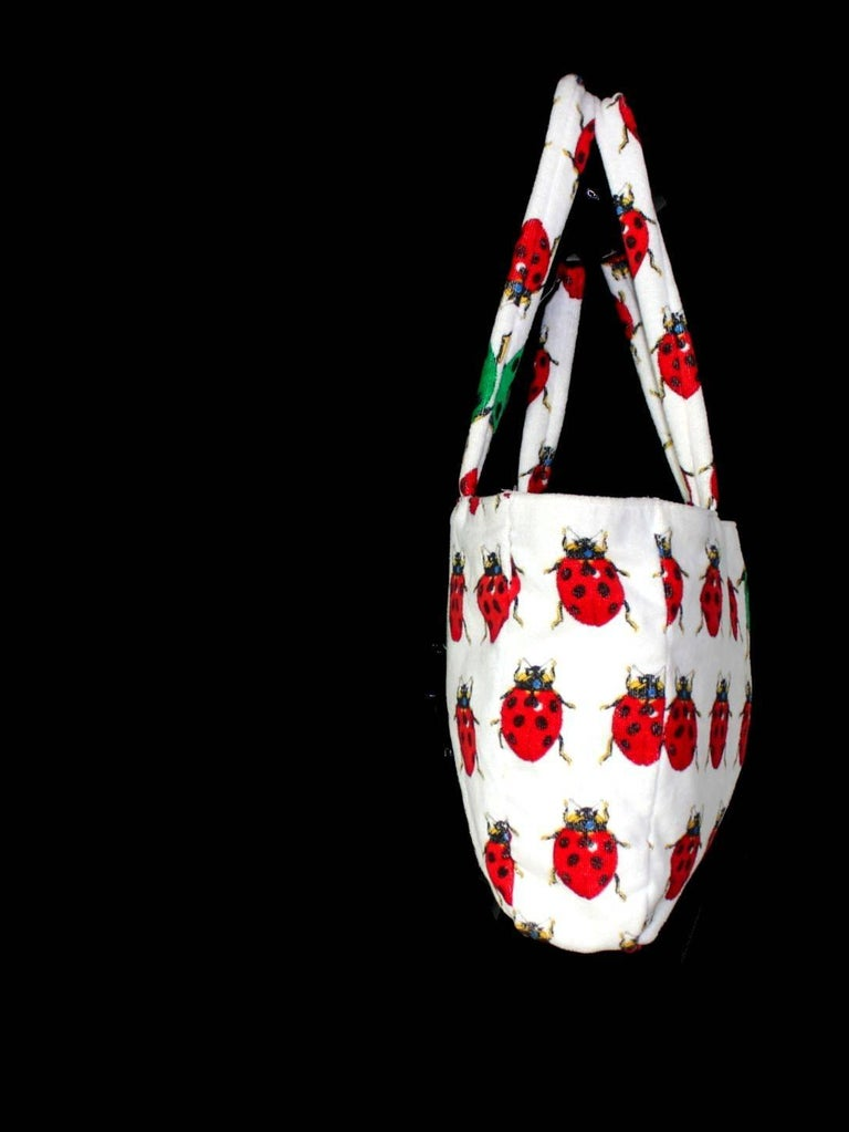 A TRUE COLLECTOR'S ITEM  CREATED BY GIANNI VERSACE FOR ONE OF HIS MOST FAMOUS COLLECTIONS EVER SS 1995    Stunning signature piece     From SS 1995 collection designed by Gianni Versace himself     Beautiful beach bag with ladybugs print White