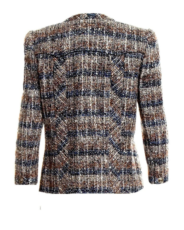 Beautiful CHANEL fantasy tweed jacket designed by Karl Lagerfeld A true CHANEL signature item that will last you for many years Stunning colors, so versatile, perfect with jeans! Closes in front with zip closure Amazing metallic tweed