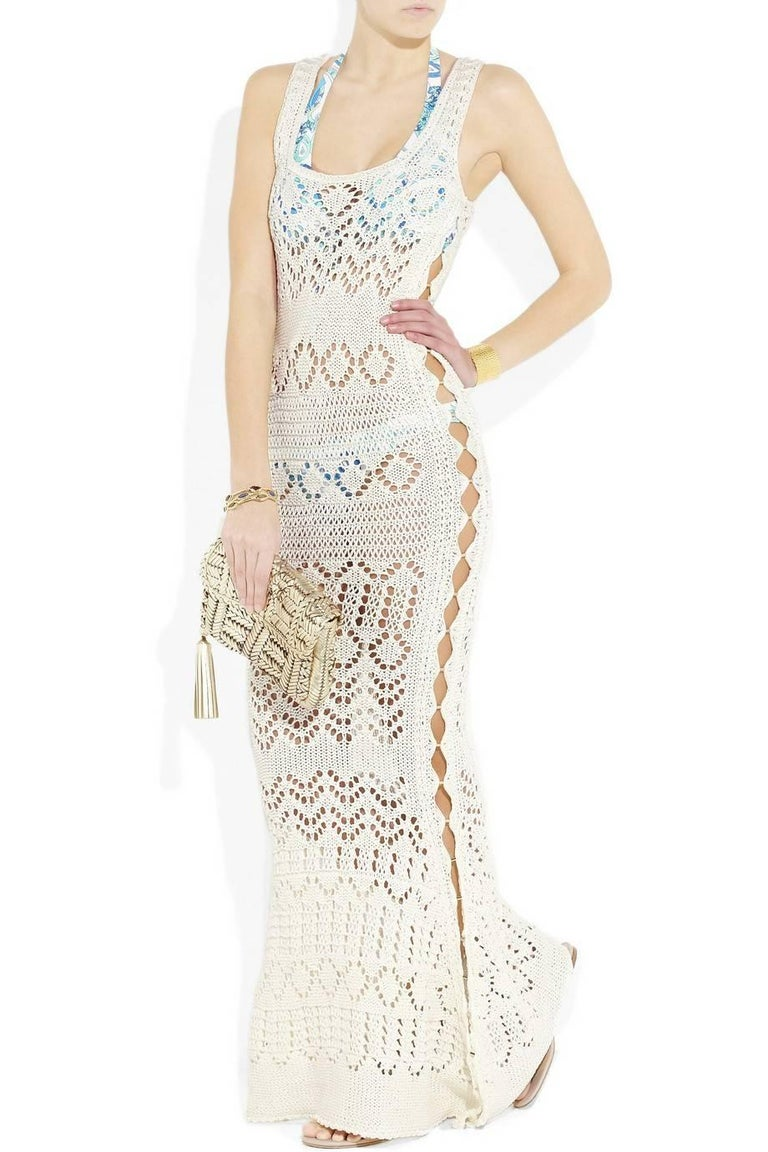 Absolutely Insane Emilio Pucci White Crochet Knit Cutout Gown   Designed By Peter Dundas   Sold Out Immediately     Details: Exclusive and gorgeous EMILIO PUCCI crochet knit gown Sexy cutout details Sleeveless Off-white crochet-knit cotton Golden