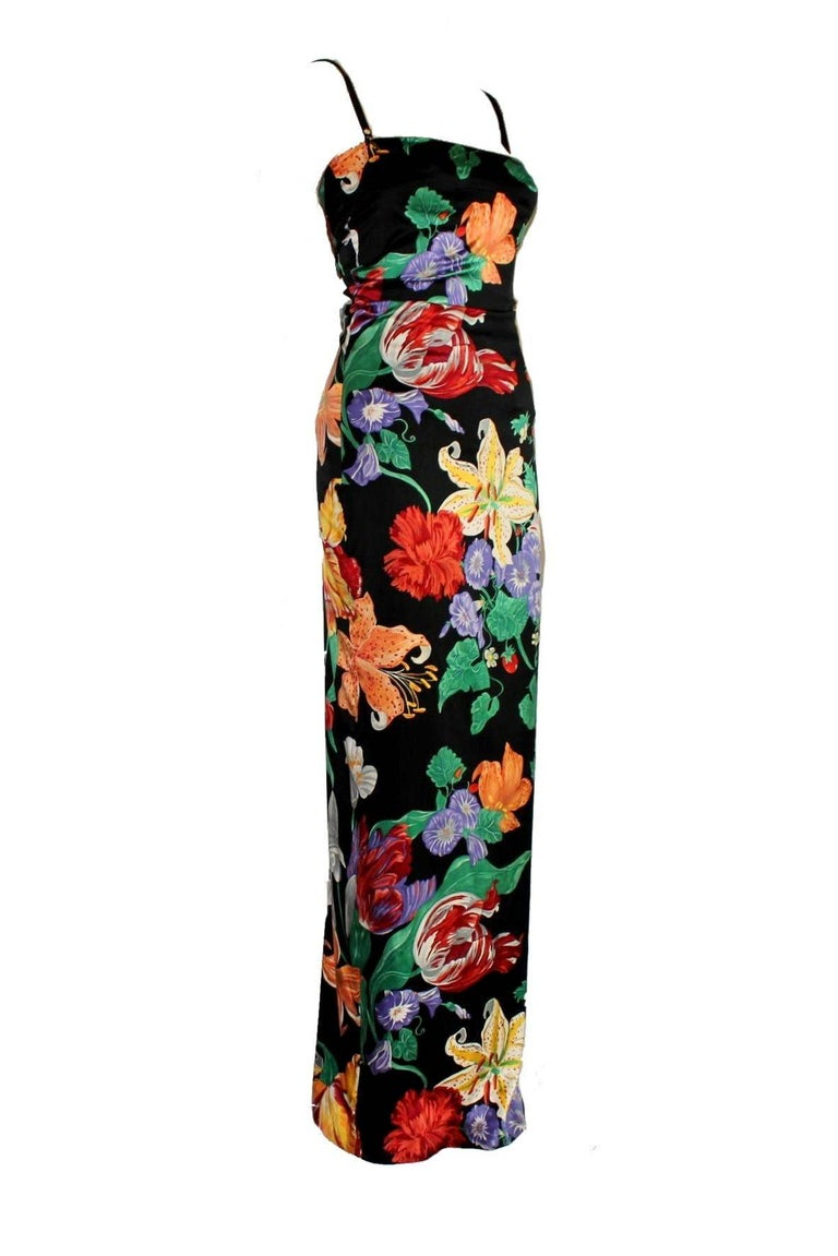 Unique Dolce & Gabbana Evening Dress     Beautifully hand-painted silk with floral design     Zipper in the back Corset-like inner part for a perfect fit     The dress is a special piece and one of a kind, you will not find someone in exactly the