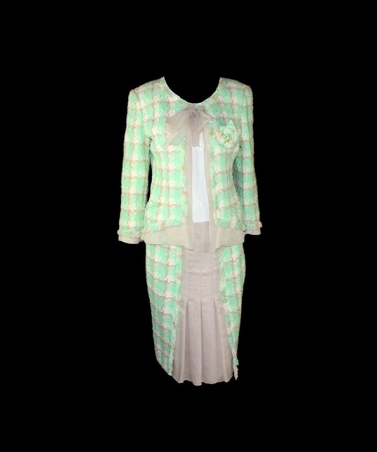 Beautiful Chanel Skirt Suit Consisting of  jacket and skirt One of the favourite pieces of Anna Wintour - she wore it several times styled differently So versatile! Jacket with two front pocket -still unopened Silk trimming and bow tie