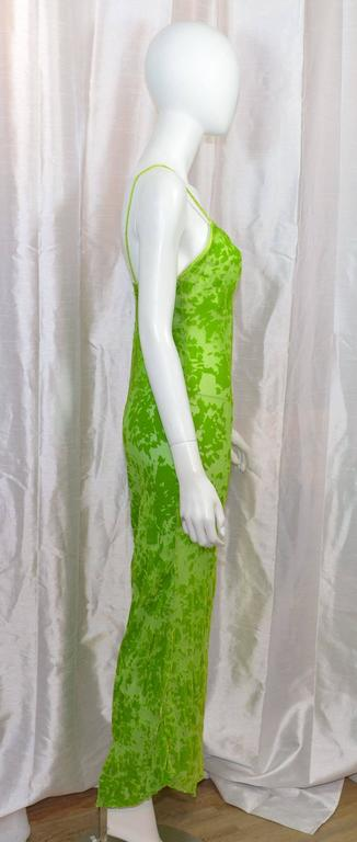 Voyage maxi slip dress featured in a lime green with cut velvet details. Bias cut fabric with a satin trim at the neckline, and satin shoulder straps. Dress is labeled