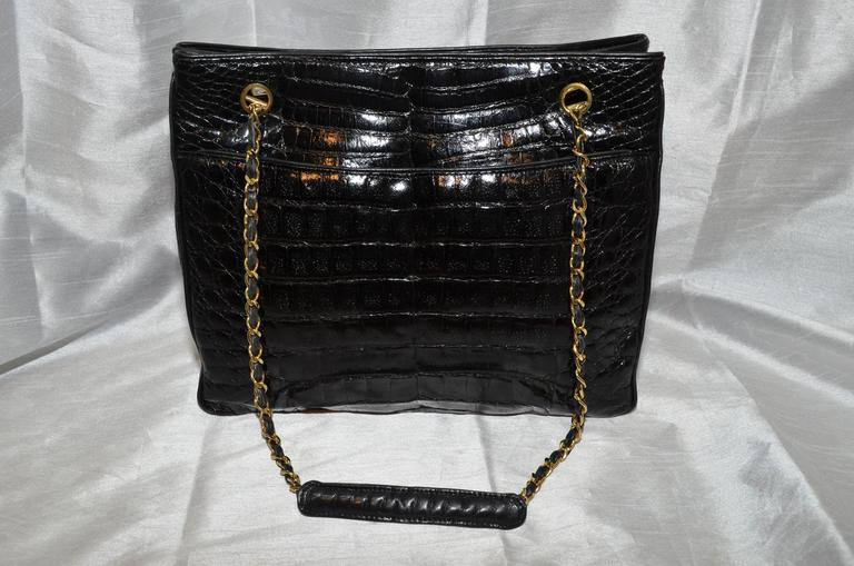 Gorgeous Chanel tote features 2 large outside compartments, 1 large inner compartment with 2 zip pockets, one on each side. Made in Italy. Excellent condition. Serial number dates the bag to 1986-1988. 