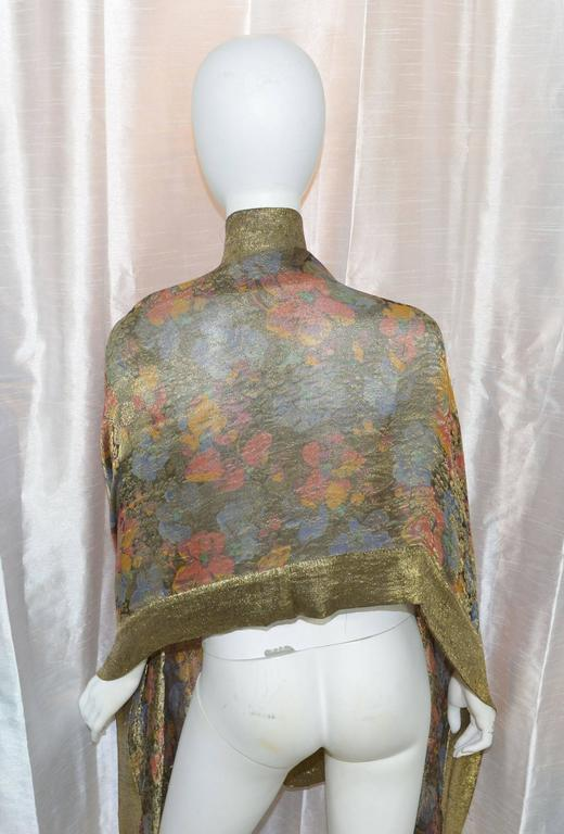 Featured is an exquisite 1920s art deco shawl made of gold