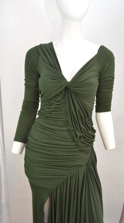 Donna Karan black label ruched evening dress with long sleeves, V neckline and slit up the right leg. Hunter green rayon jersey that is matte and feels like cotton has been ruched and draped in the most flattering way. Dress is in excellent