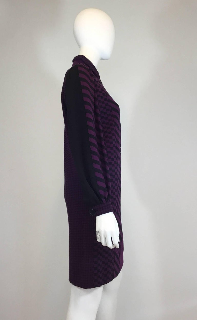 Rudi Gernreich for Harmon Knitwear 1960's Vintage Wool Knit Multi-pattern purple and black dress made of 100% wool. Dress features front button closures, billow sleeves also with button closures, and a mixed geometric pattern throughout. Excellent