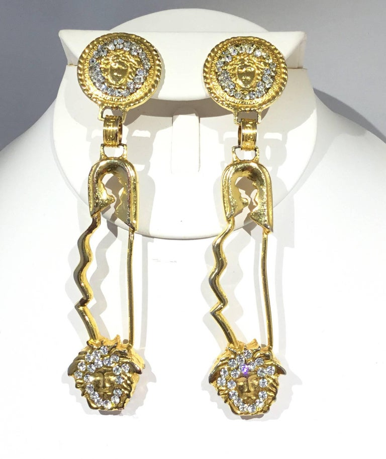 Iconic Gianni Versace Vintage 1990s Safety Pin Clip On Earrings Featured In Gold Tone With A
