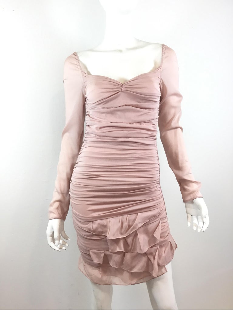 Gorgeous Runway dress from Tom Ford for Gucci's 2003 Spring collection. Dress is featured in a nude pink color, composed of  a silk and spandex blend, labeled Size 38, made in Italy. Dress has an open back with strappy detail across the back and a