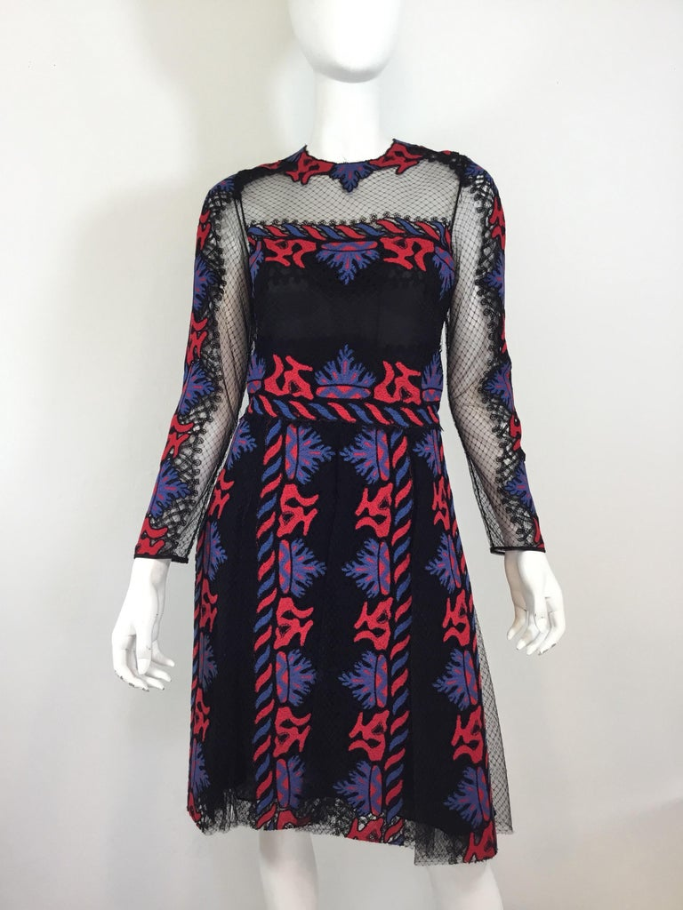 "Valentino black caged dress with red and blue embroidery and a car wash Pleated skirt. Dress has a back zipper and hook fastening, size 42, made in Italy.   Bust 36"", waist 29"", hips 34"", sleeves 23"", length 40"""