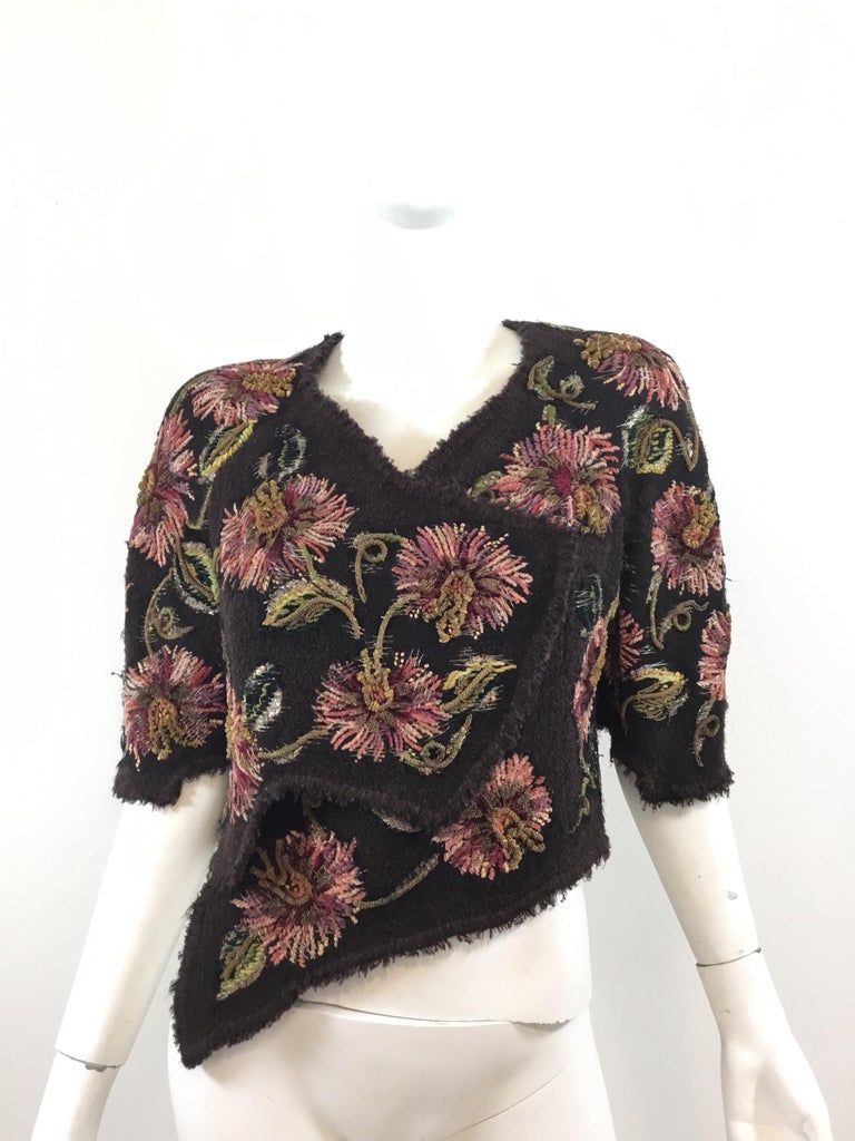 Amazing and rare Chanel Lesage Tweed bolero jacket featured in a brown, wool fabric with chainwork and lamé threading throughout the floral detail. Bolero is fully lined and has concealed snap fastenings. Circa 1940's, Excellent vintage condition.