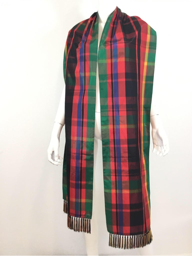 Yves Saint Laurent Vintage scarf/shawl in a tartan pattern design, taffeta fabric with fringed ends. 100in. Long, 13in. wide. Made in France. Some water spots on the taffeta fabric as pictured.