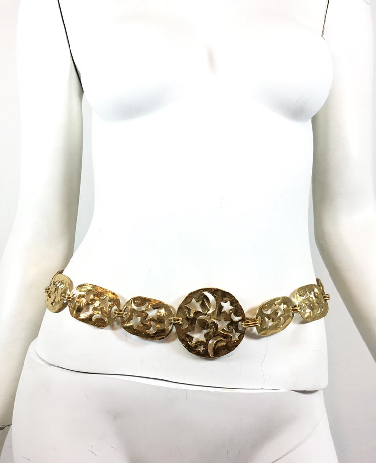 "Yves Saint Laurent Gold chain belt with cutout stars and moons throughout. Belt measures approximately 29"" Long, plates are 1.5 inches wide with the largest being 2.5"" x 2.5"". Hook closure.  Excellent condition!"