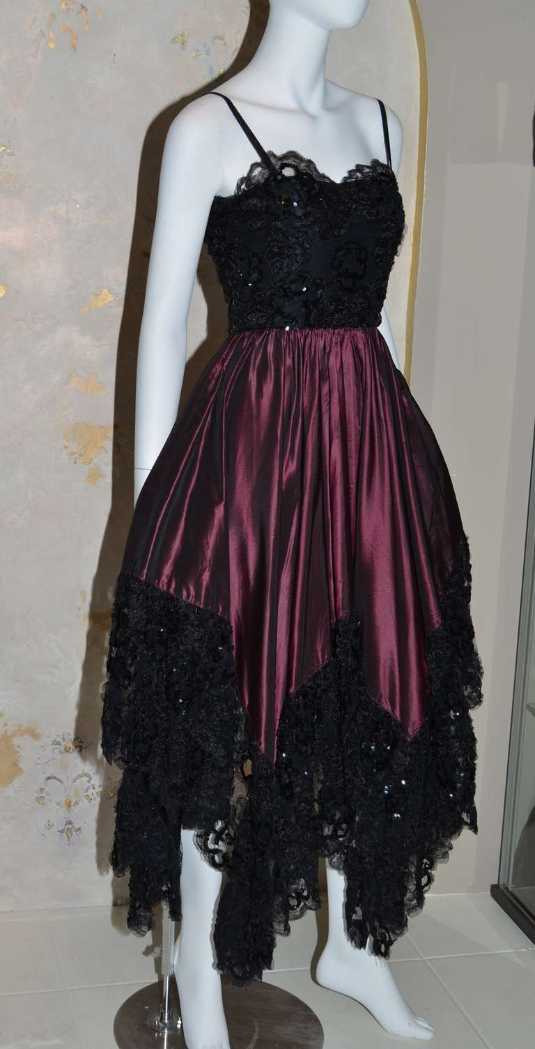 Yves Saint Laurent Vintage 1970's Iridescent Silk Taffeta Gown with Lace bodice and Lace Handkerchief Hem. Comes with matching Ruffle Trim Shawl. Removable sash tie belt. Metal Side Zipper.