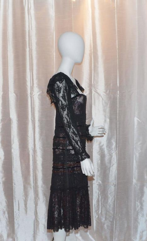 Very lightweight vintage Giorgio Sant Angelo dress features a square neckline trimmed with black velvet ribbon. Bodice of dress has both black velvet and rust satin ribbon. Lined in a sheer rust lace with silver and maroon flowers. Silver shines