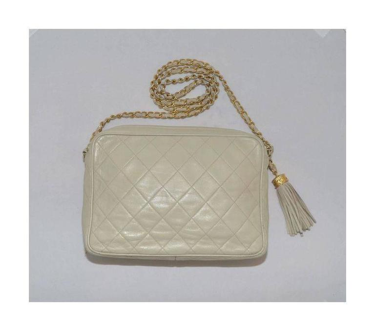 Vintage Chanel bag from 1986-1988. Vintage Leather Camera Bag with Tassel has a soft leather tassel as a zipper closure along the top, quilting to the leather at the front and back, and one slip pocket at the front. Lined in leather with one zipper